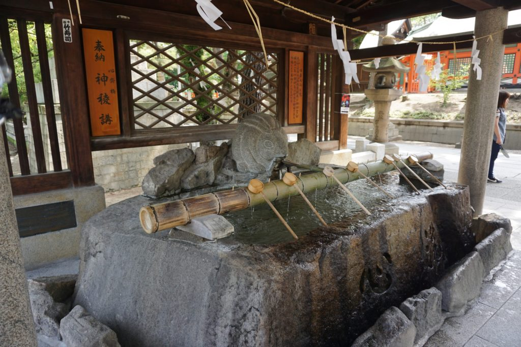 A water cleansing area at a Japanese shrine in Osaka