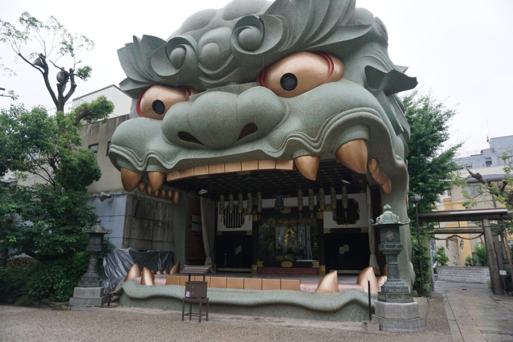 A large Japanese shrine that resembles a dragon's face (Namba Yasaka Shrine - Osaka)