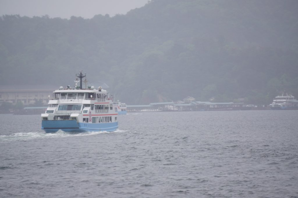 Large boat (ferry) on water traveling back from Miyajima Island in Japan