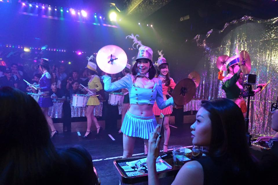 Girl in costume dancing at the Robot Restaurant in Tokyo