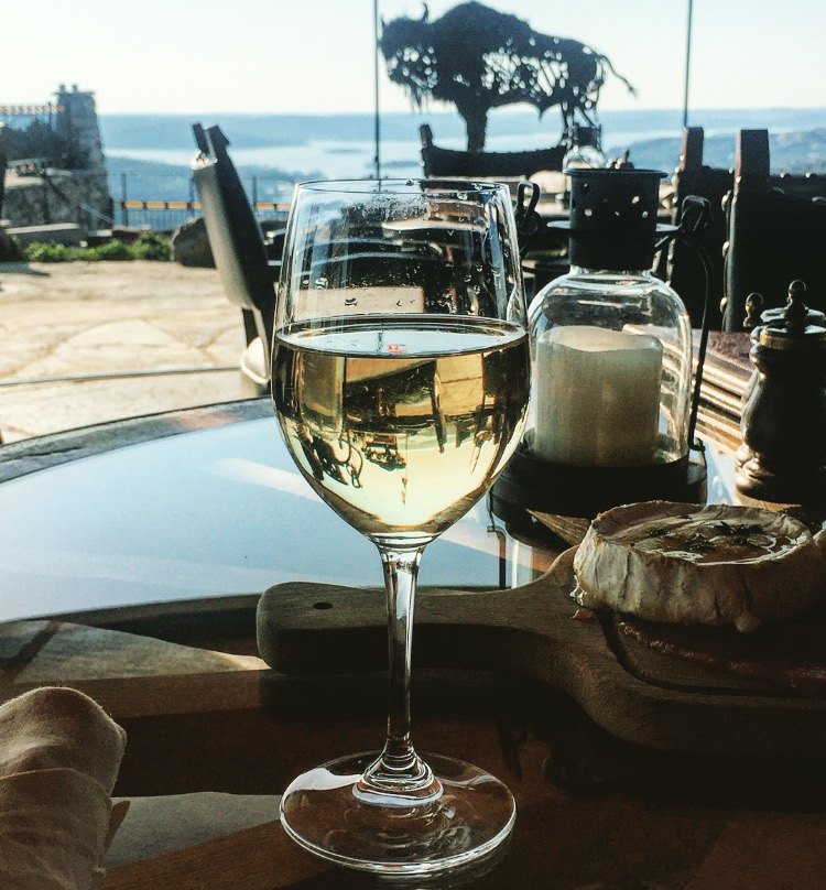 A glass of white wine at the Buffalo Bar at Big Cedar Lodge