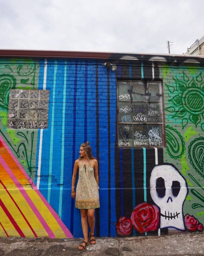 Woman standing in front of a mural in Denver, Colorado (unique things to do in Denver)