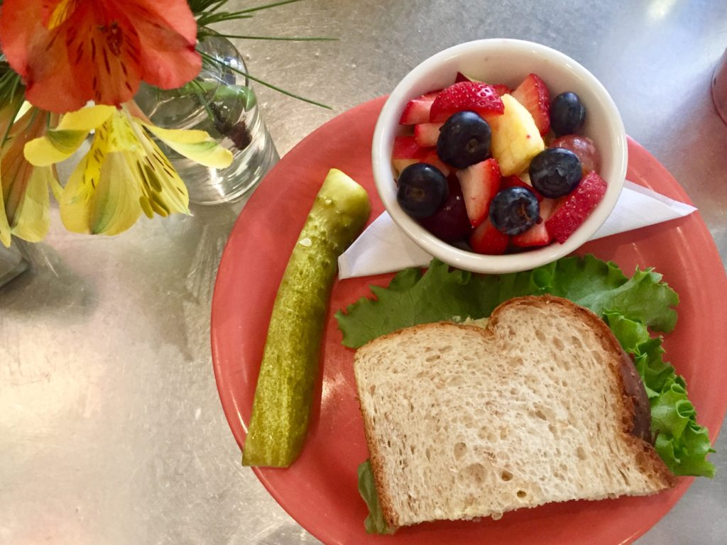 Egg Salad Sandwich with fresh fruit at Queenies in Tulsa