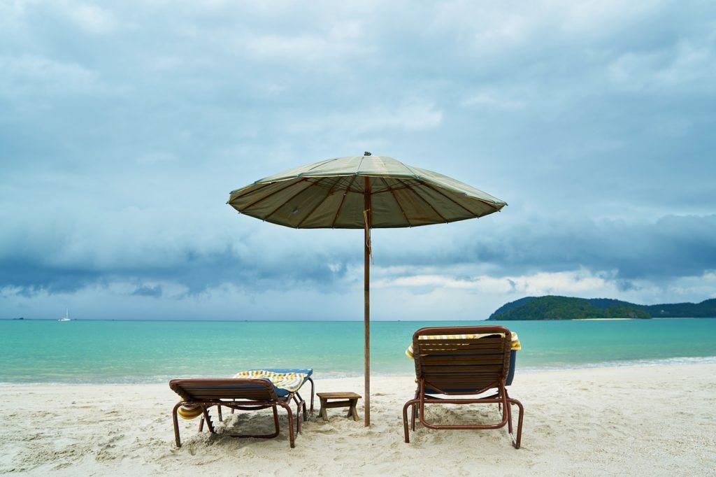 Beach chairs and umbrella - beach packing tips