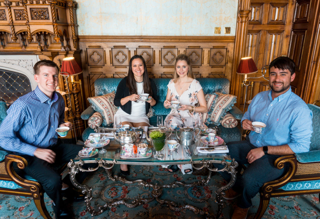 Two couples sitting in a room for tea at the Ashford Castle Afternoon Tea Experience