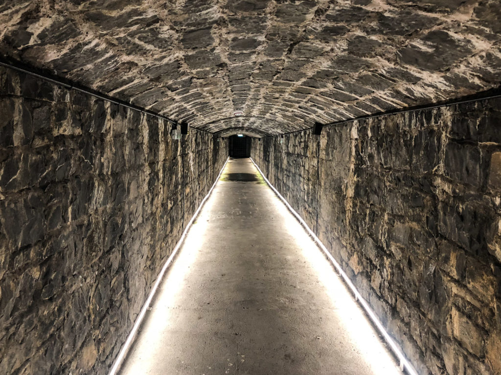 Lit up underground tunnel leading to a wine cellar in Ashford Castle