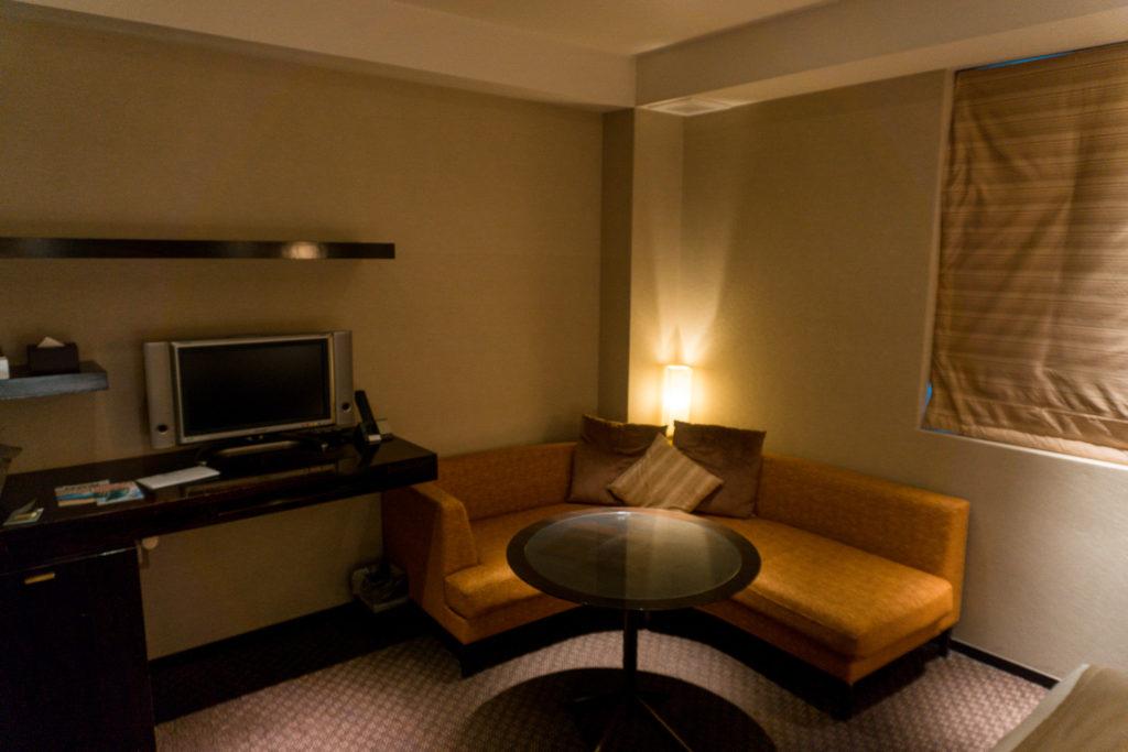 Seating area in a hotel room at Hotel Il Palazzo - Fukuoka