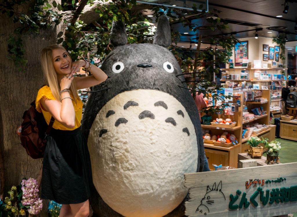 Woman posing with a statue of Totoro - Fukuoka, Japan