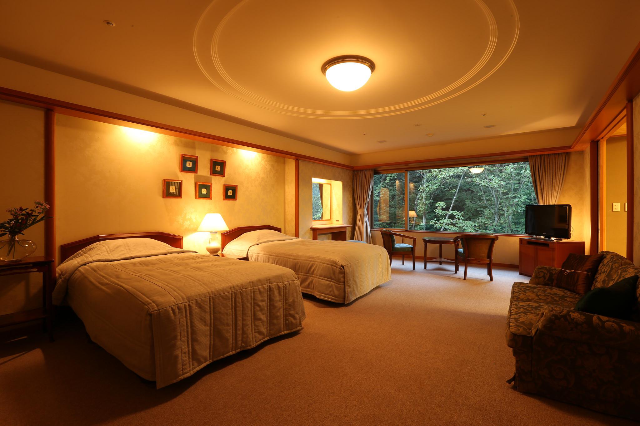 Japanese and Western style Hybrid Hotel Room at Nishimuraya Hotel Shogetsutei - Kinosaki Onsen, Japan
