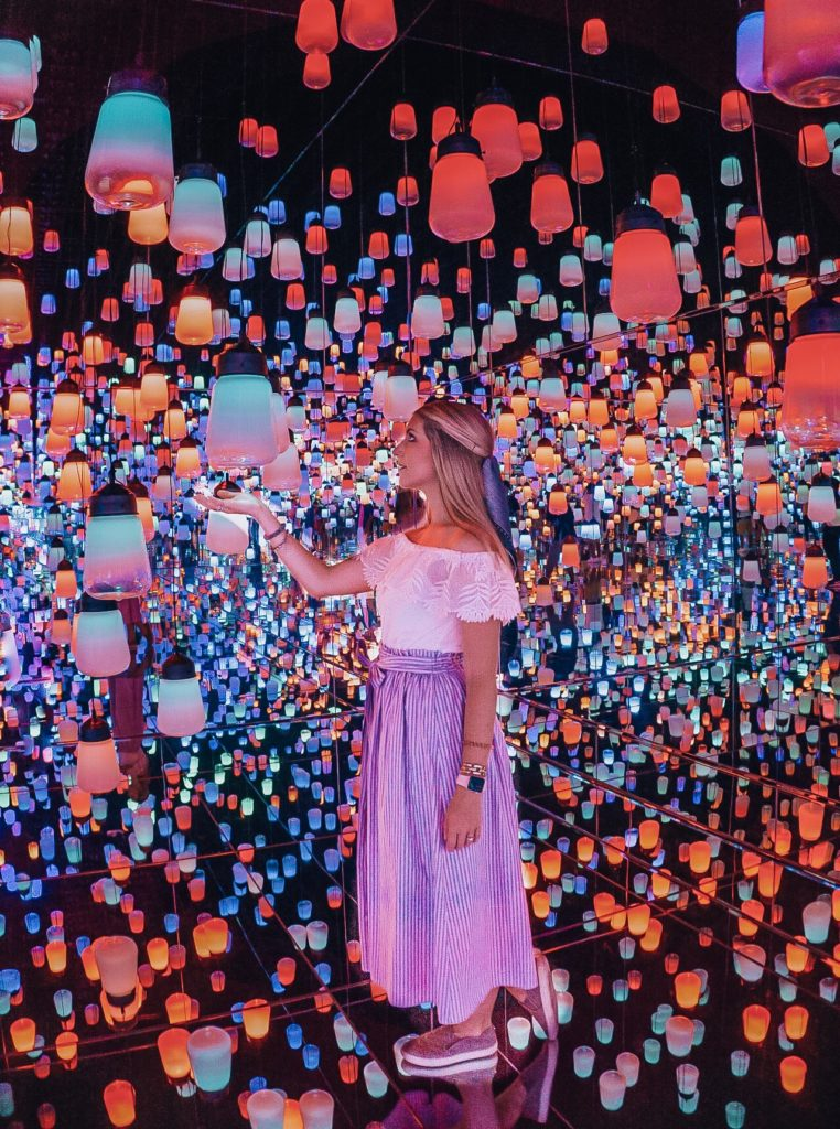 Girl standing in a room of colorful lanterns (Mori Digital Art Museum - Tokyo)