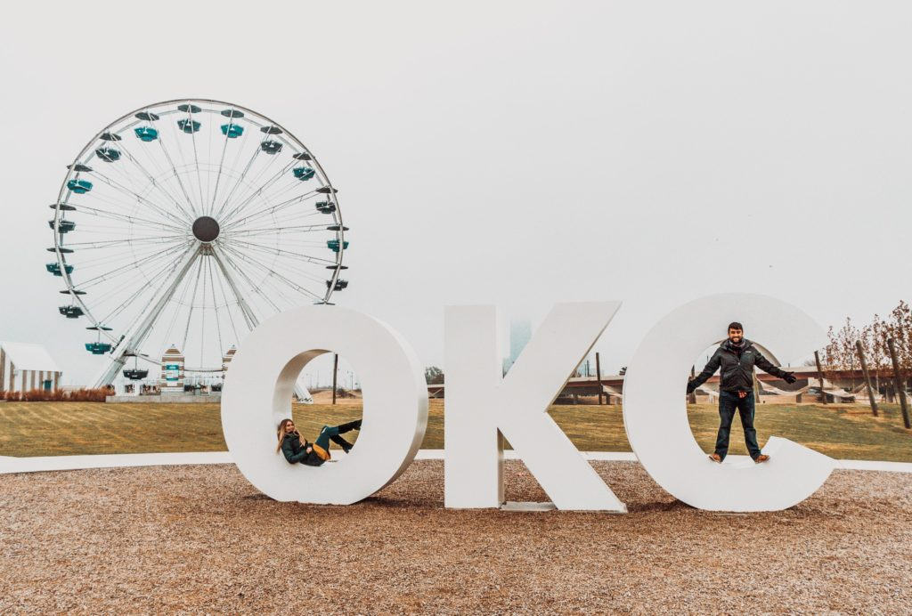 OKC sign in front of Wheeler Ferris Wheel in OKC