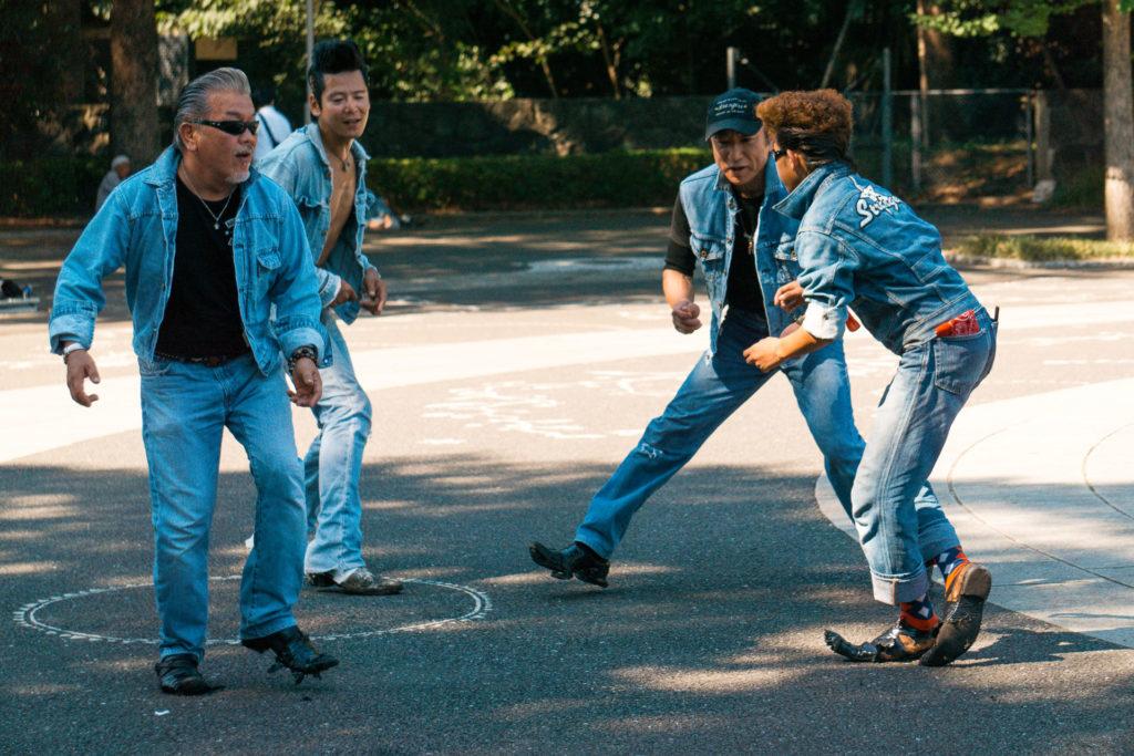 Men dressed in denim dancing (Tokyo rockabilly)