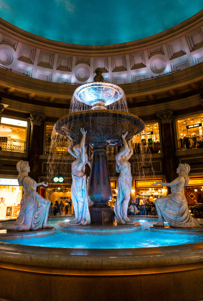 Fountain with statues around it at VenusFort Mall Tokyo