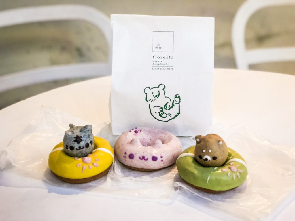 Three donuts shaped to look like animals (cat and bear).