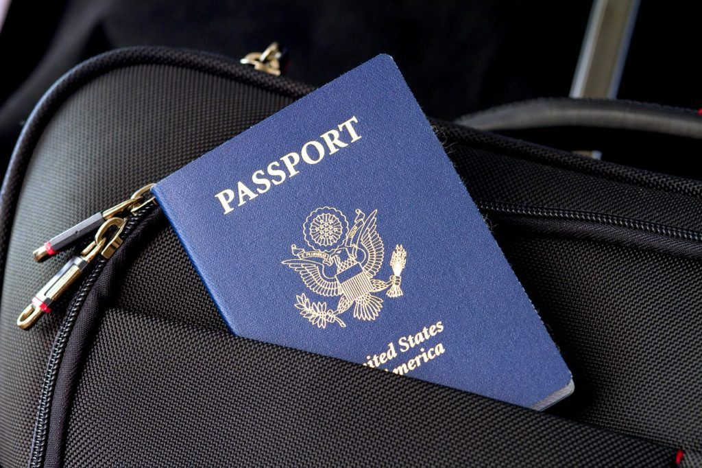 United States passport inside a suitcase