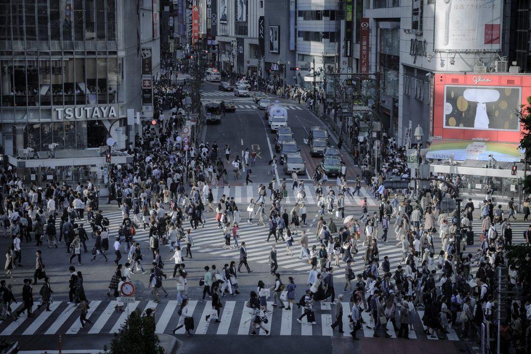 A large number of people walking on a crosswalk (Shibuya Pedestrian crossing in Tokyo, Japan)