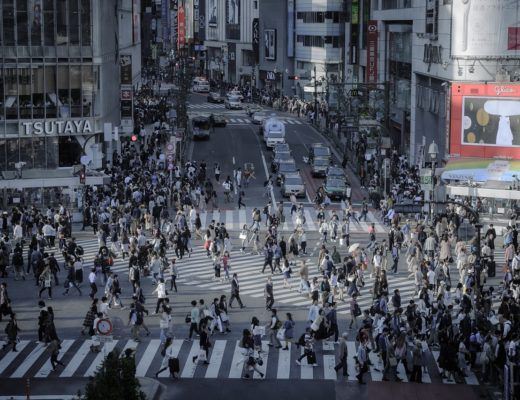 A large number of people walking on a crosswalk (Shibuya Pedestrian crossing in Tokyo, Japan)