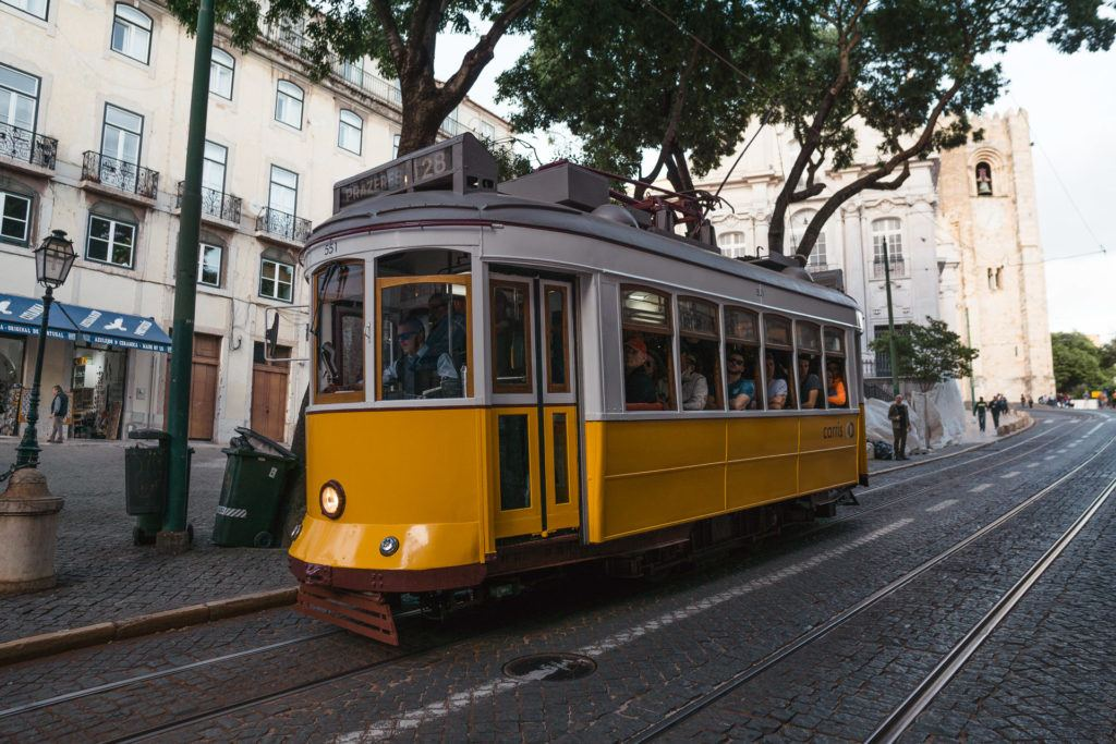 The yellow Tram 28 in Lisbon, Portugal.