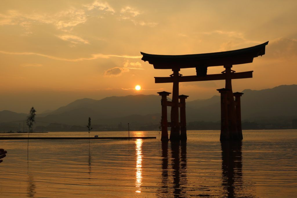 How to start travel hacking post - image of Miyajima floating torii gate in Japan
