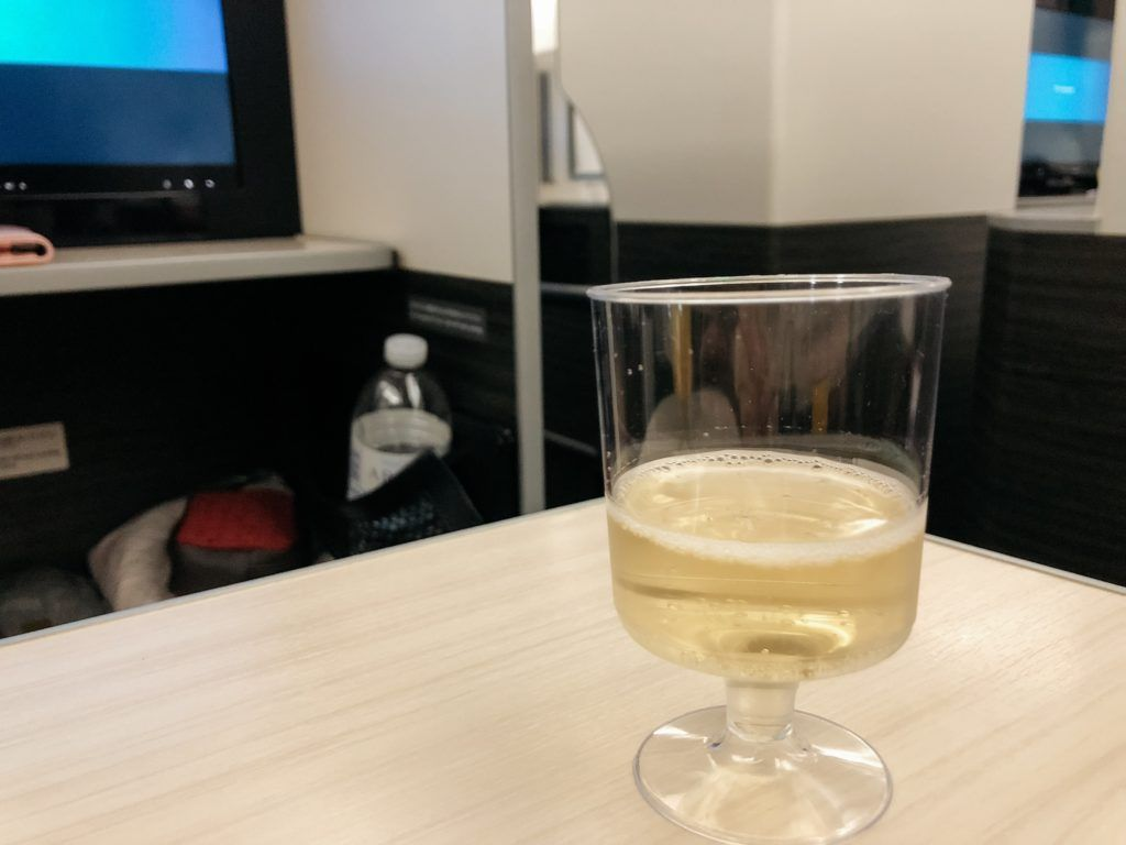 Complimentary champagne on JAL business class flight