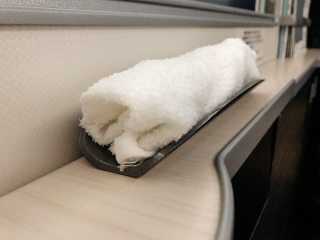 Hot towel provided by Japan Airlines at the beginning of business class flight.