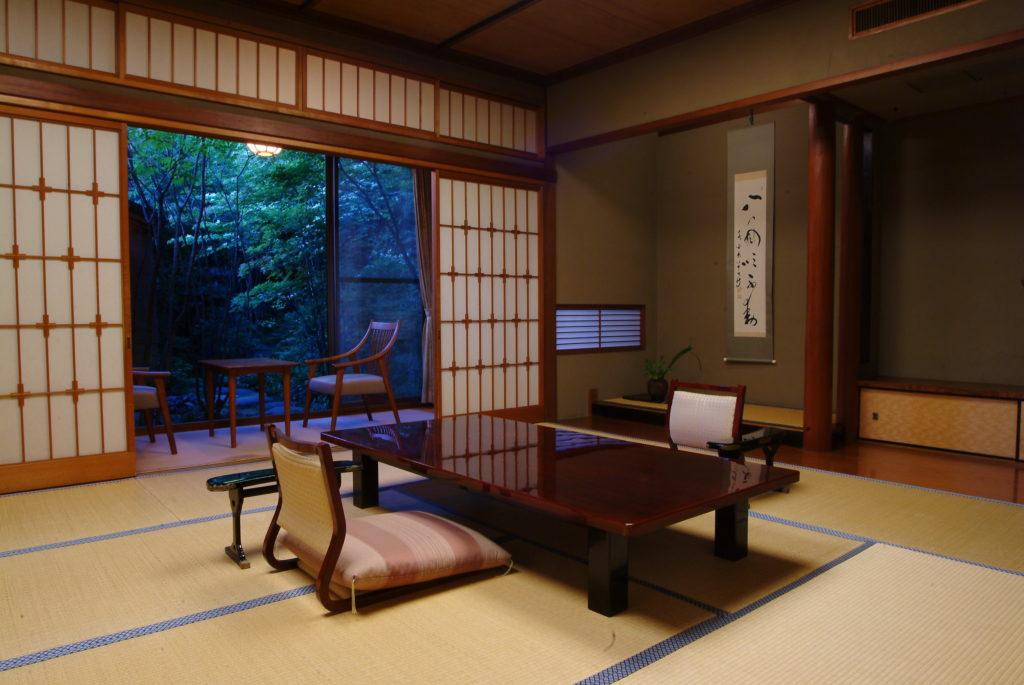View of the garden area and open-air bath from the living space in the Hatsune Room at  Nishimuraya Honkan.