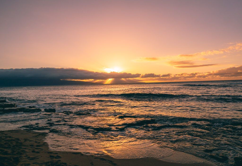Sunset on a beach in Maui. (A 7 day Maui itinerary)