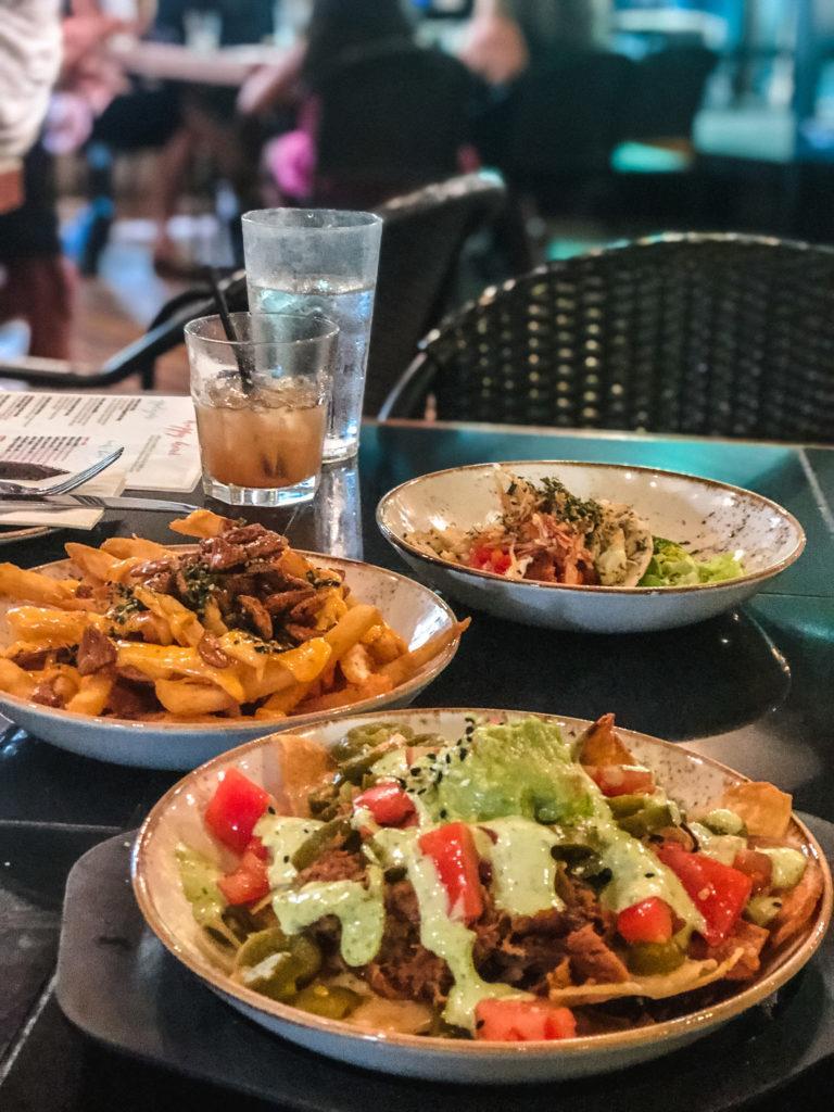Happy hour menu items at Three's Bar & Grill in Maui.