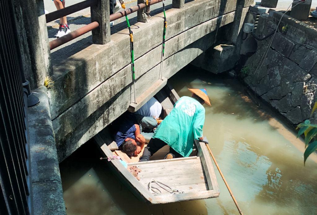 Ducking under a bridge on a boat in Yanagawa