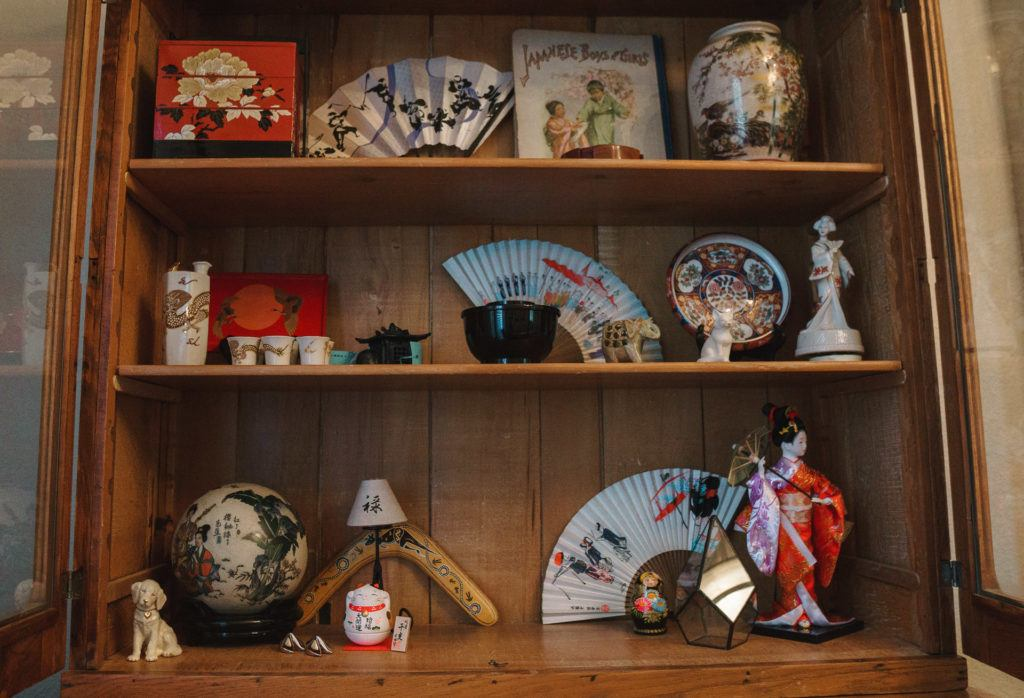 China cabinet decor - decorating with travel souvenirs