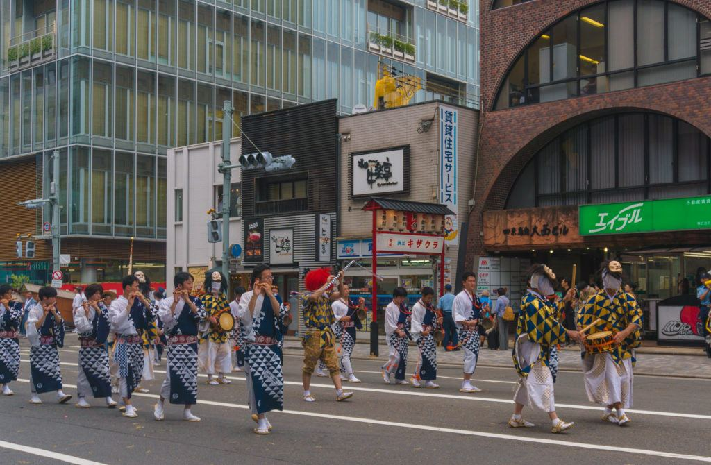 People playing instruments at Gion Matsuri