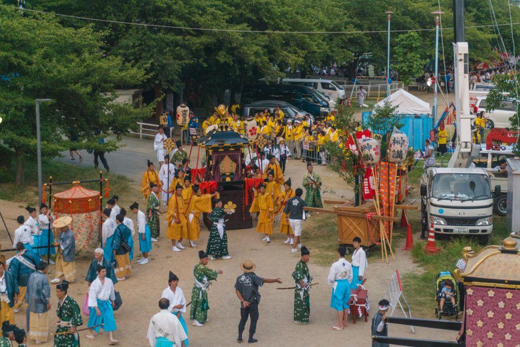 Shrines being loaded into boats at Tenjin Matsuri